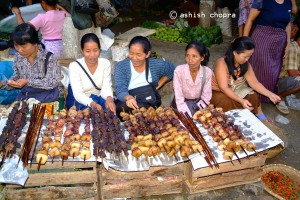 Pork is the favourite meat of the tribals of North east the picture shows women selling smoked pork